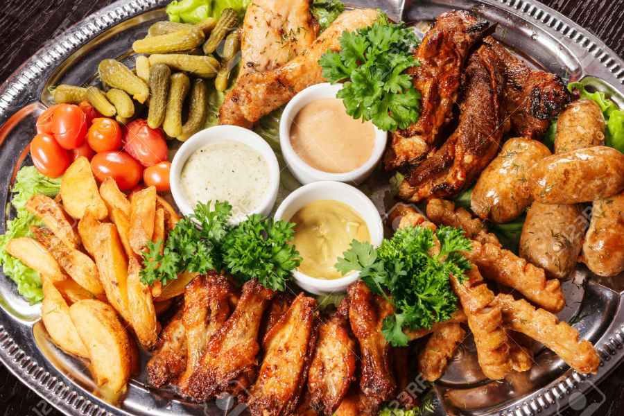 24171427-Huge-choice-of-different-meat-dishes-on-one-plate-with-spices-and-vegetables-Stock-Photo-w900-h600
