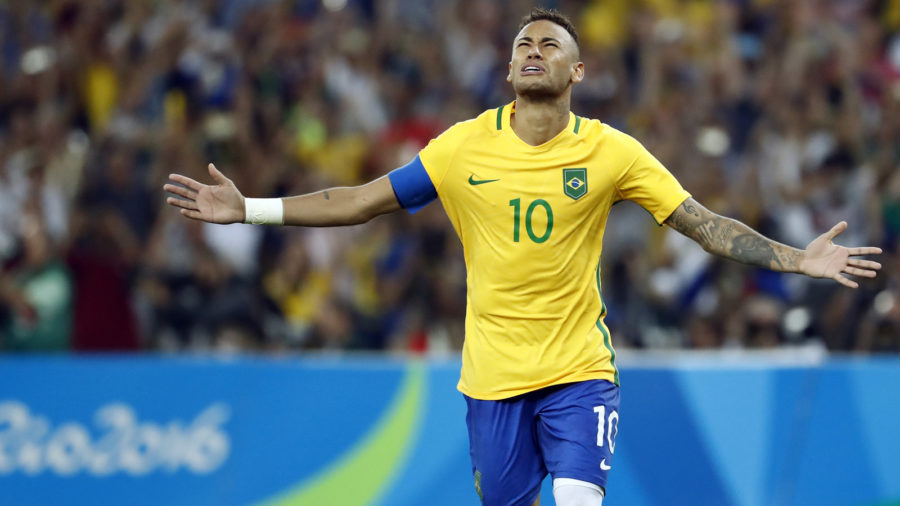 Brazil's forward Neymar celebrates scoring the winning goal during the penalty shoot-out of the Rio 2016 Olympic Games men's football gold medal match between Brazil and Germany at the Maracana stadium in Rio de Janeiro on August 20, 2016. / AFP / Odd Andersen (Photo credit should read ODD ANDERSEN/AFP/Getty Images)