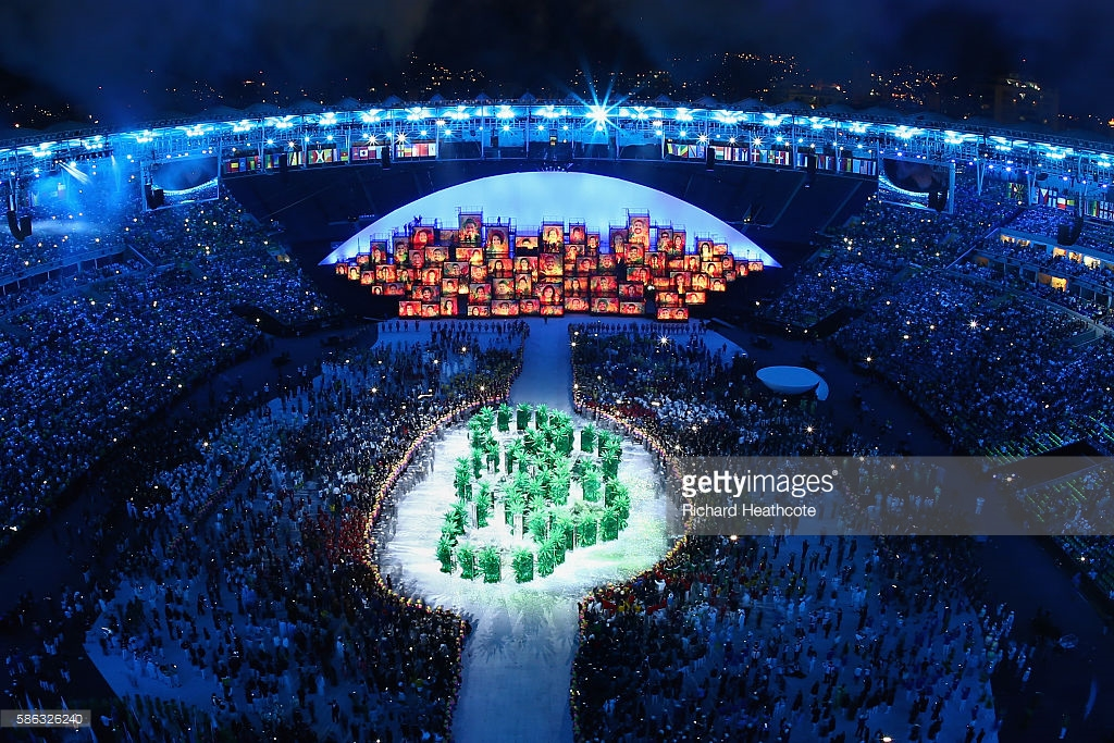 RIO DE JANEIRO, BRAZIL - AUGUST 05: The Olympic Rings are formed in green foliage during the Opening Ceremony of the Rio 2016 Olympic Games at Maracana Stadium on August 5, 2016 in Rio de Janeiro, Brazil. (Photo by Richard Heathcote/Getty Images)