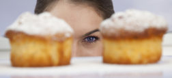 Young woman looking at freshly bakes cakes