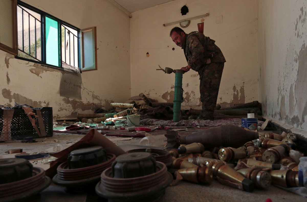 a-syria-democratic-forces-fighter-inspects-a-room-that-according-to-the-sdf-was-used-by-isis-militants-to-prepare-explosives-in-manbij