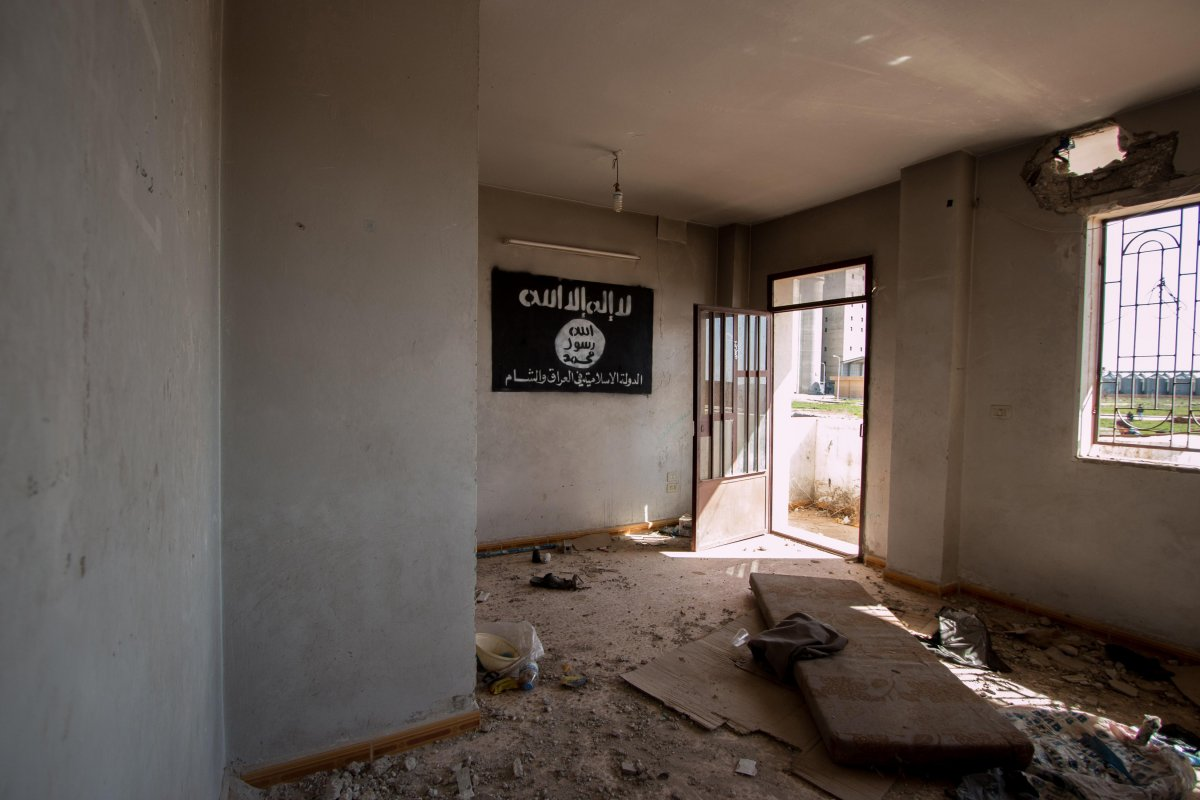 an-isis-flag-hangs-on-the-wall-of-an-abandoned-building-in-tell-hamis-syria-after-the-kurdish-peoples-protection-units-or-ypg-took-control-of-the-area-from-isis-militants