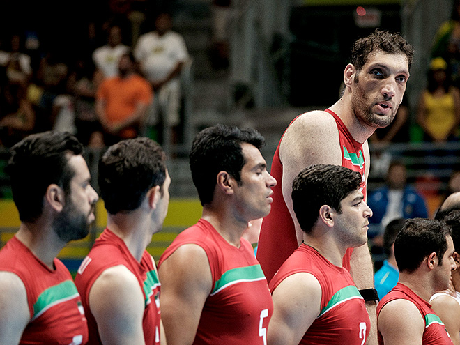 Iran's tallest sitting volleyball player Morteza Mehrzadselakjani stands with teammates before a preliminary match against Ukraine in the Paralympic Games at Riocentro in Rio de Janeiro on September 14, 2016. / AFP / YASUYOSHI CHIBA (Photo credit should read YASUYOSHI CHIBA/AFP/Getty Images)