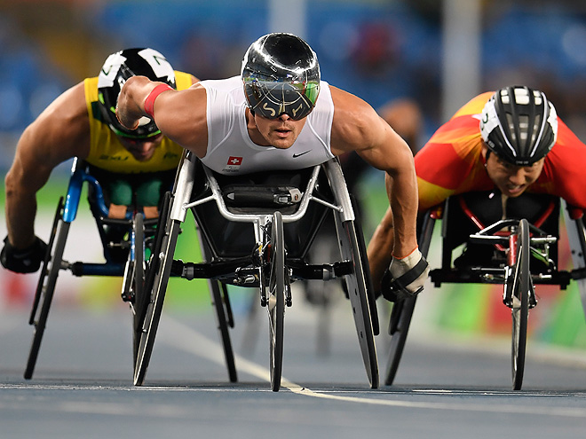 Athletes compete in the men's preliminary 1500m wheelchair race at the Olympic Stadium during the Paralympic Games in Rio de Janeiro, Brazil on September 12, 2016. / AFP / CHRISTOPHE SIMON (Photo credit should read CHRISTOPHE SIMON/AFP/Getty Images)