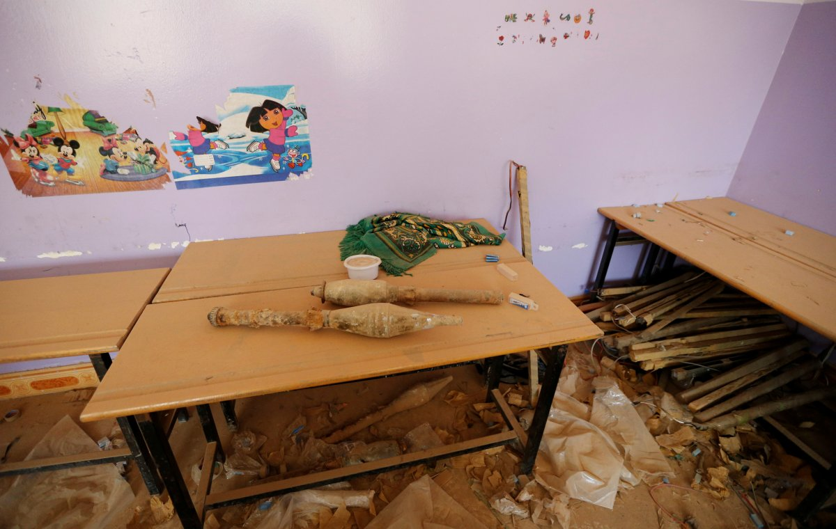 rocket-propelled-grenades-are-stacked-at-a-school-following-clashes-in-fallujah