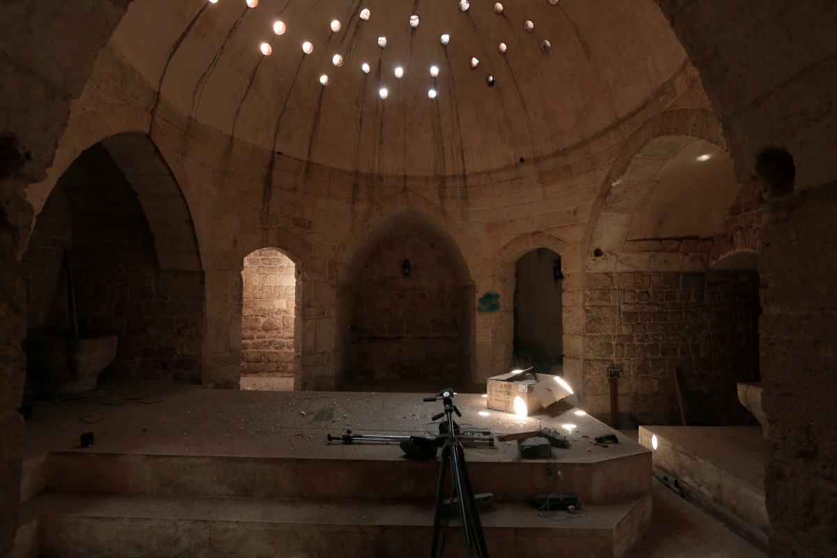 tripods-and-a-projector-inside-an-ancient-hammam-or-steam-bath-that-was-used-by-isis-as-a-media-center-in-manbij-syria