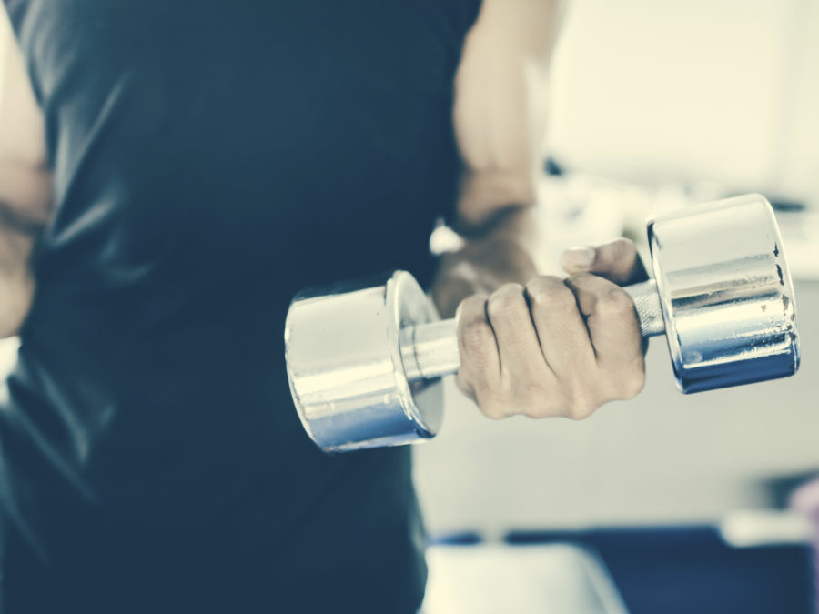 gym man lifting heavy free weights