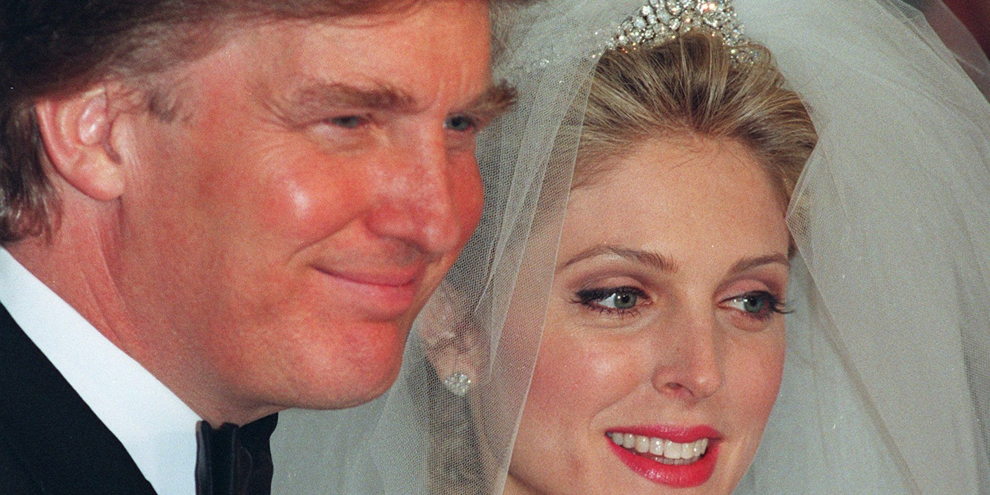 FILE--Donald Trump and Marla Maples pose for photographers following their wedding ceremony in New York, as seen in this December 1993 file photo. Trump and Maples, his wife of three years, are on the verge of breaking up, the New York Post reported Friday, May 2, 1997. ``Donald wants out. He's looking for his freedom,'' the newspaper said, quoting unidentified sources. (AP Photo/Kathy Willens, File)