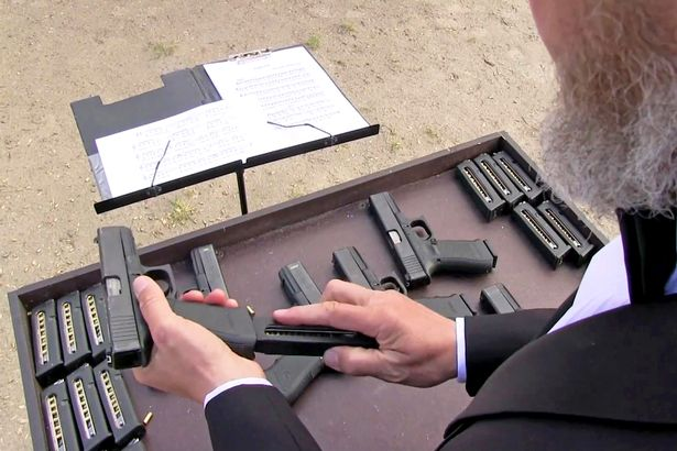 pay-vitaly-kryuchin-loads-a-glock-in-order-to-make-music-with-it-1