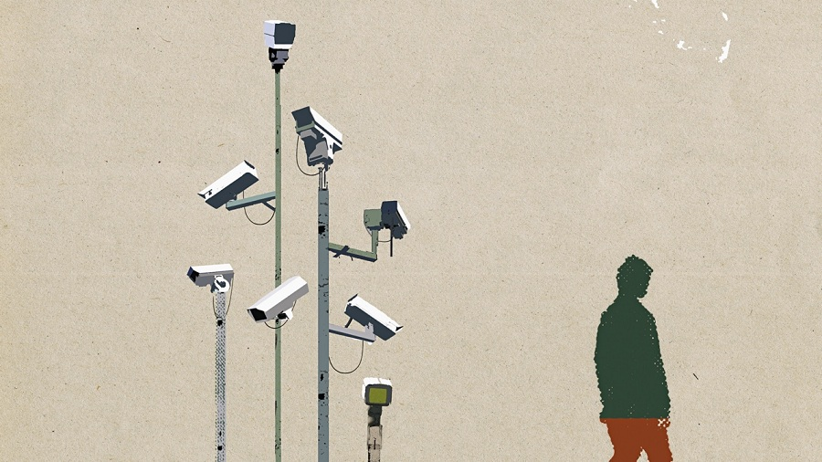 Man waking beneath surveillance cameras