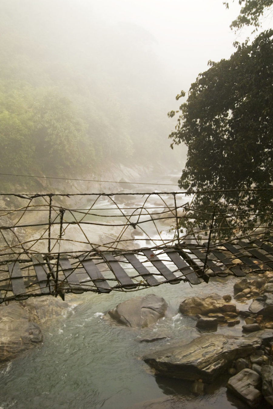 Rickety foot bridge in Northern Hilltribe trekking city of Moung Mon on the border of China (Sapa Region).