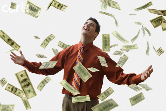 Money Falling on Happy Businessman --- Image by © JLP/Jose L. Pelaez/Corbis