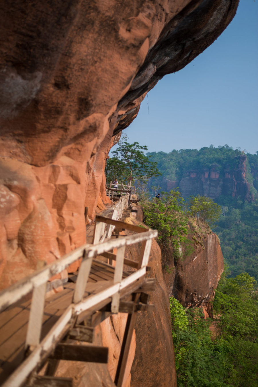 Wooden bridge in red cliffside at Wat Phu tok mountain Bueng Kan, ThailandWooden bridge in red cliffside at Wat Phu tok mountain Bueng Kan, ThailandWooden bridge in red cliffside at Wat Phu tok mountain Bueng Kan, Thailand