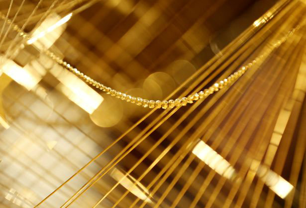 a-close-up-view-of-a-gold-christmas-tree-decorated-with-19-kilograms-418-lbs-of-pure-gold-wires-w700