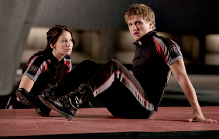 Katniss Everdeen (Jennifer Lawrence) and Peeta Mellark (Josh Hutcherson) in THE HUNGER GAMES.