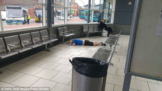 3E01102F00000578-4302806-Another_man_was_pictured_lying_face_down_on_the_floor_of_the_bus-a-49_1489182669495-w700