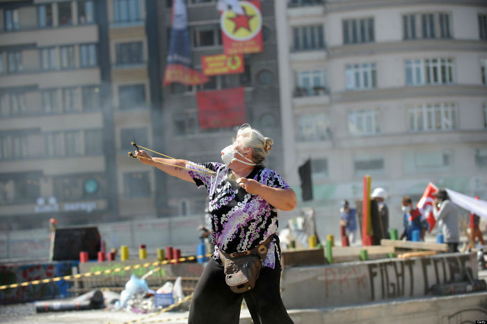 o-TURKISH-PROTESTER-SLINGSHOT-facebook-58c062aae2638__700-w700