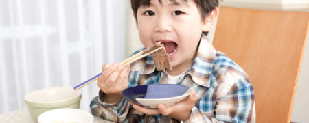 Japanese boy eating meat; Shutterstock ID 178891739; PO: today.com