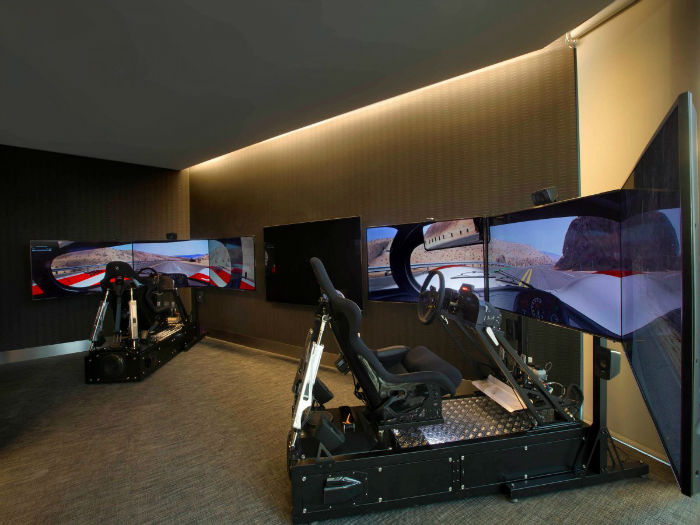 -and-a-game-room-complete-with-golf-and-racing-simulators-w700