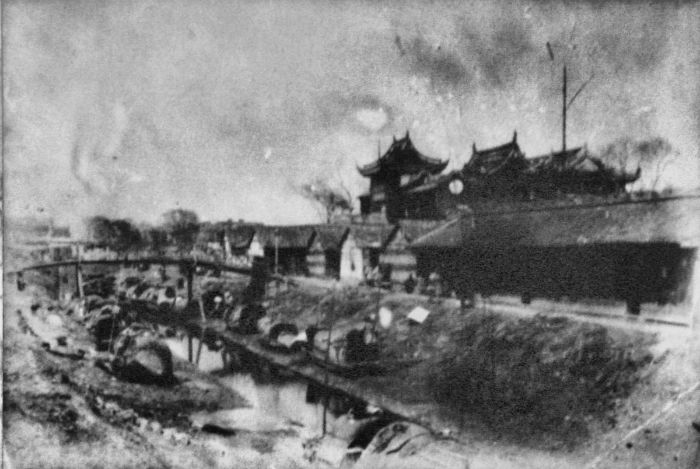 the-old-city-of-shanghai--pictured-here-in-the-1880s--came-complete-with-moat-w700