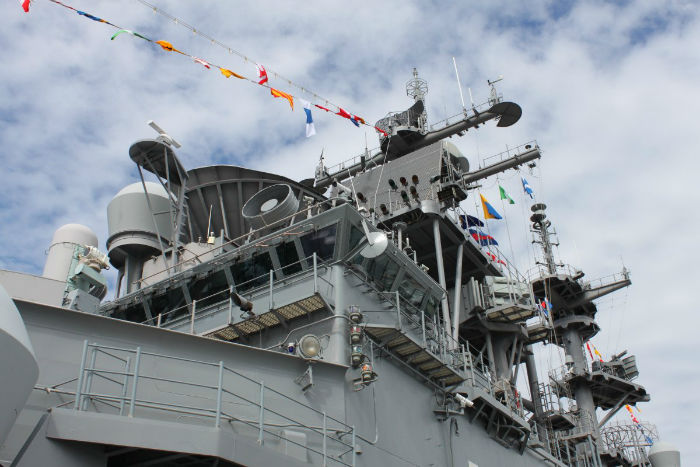 a-close-up-of-the-superstructure-shows-its-hodgepodge-of-antennas-signals-lights-and-masts-w700