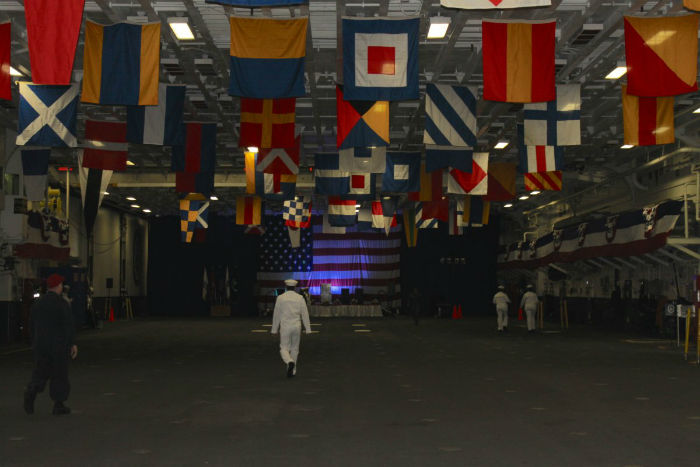 above-the-well-deck-is-the-kearsarges-hanger-bay-where-aircraft-are-stored-and-maintenance-is-done-it-is-also-used-by-the-crew-for-ceremonies-and-gatherings--and-when-needed-calisthenics-w700