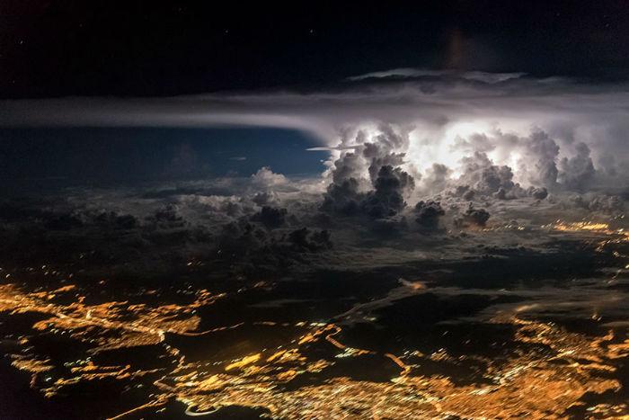 pilot-clouds-lightning-night-skies-santiago-borja-lopez-15-591954ce7e759__880-w700