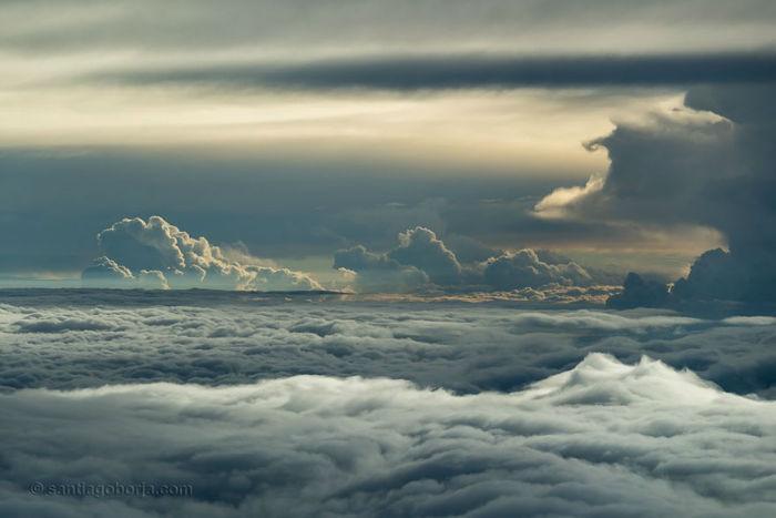 pilot-clouds-lightning-night-skies-santiago-borja-lopez-20-591954da649a3__880-w700