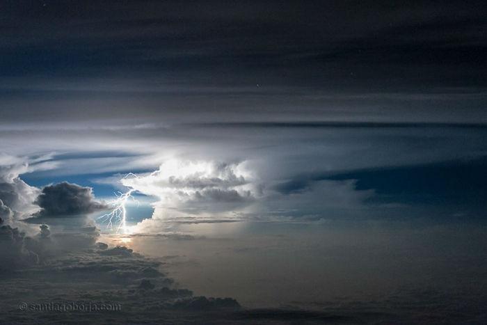 pilot-clouds-lightning-night-skies-santiago-borja-lopez-23-591954e15c007__880-w700
