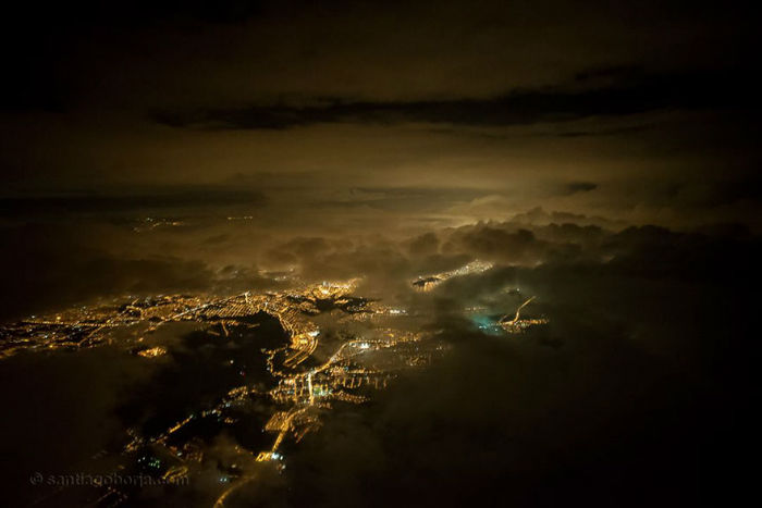 pilot-clouds-lightning-night-skies-santiago-borja-lopez-3-591954b55f12b__880-w700