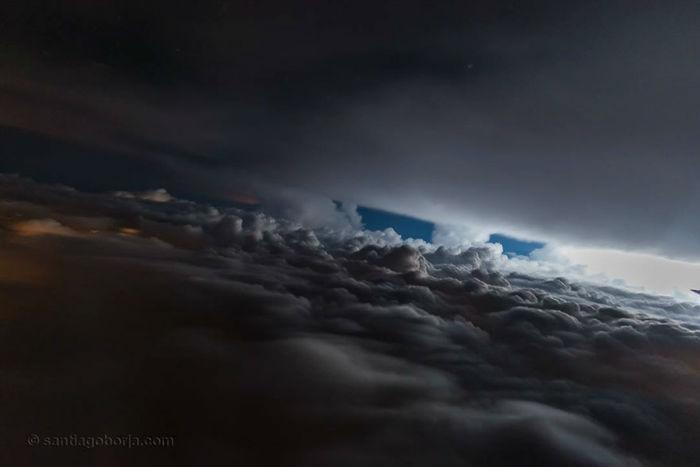 pilot-clouds-lightning-night-skies-santiago-borja-lopez-7-591954bd3b08a__880-w700