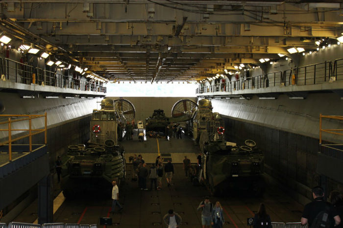 the-lower-section-of-the-well-deck-seen-here-loaded-with-amphibious-vehicles-and-a-landing-craft-air-cushion-can-be-ballasted-with-up-to-10-feet-of-water-allowing-landing-craft-to-enter-and-exit-w700