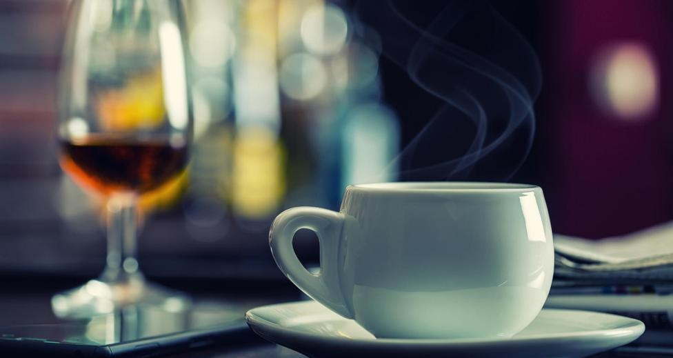 FRP5MP Coffee and drink. Cup of Coffee and Cognac Brandy Whiskey Aperitif in modern night bar