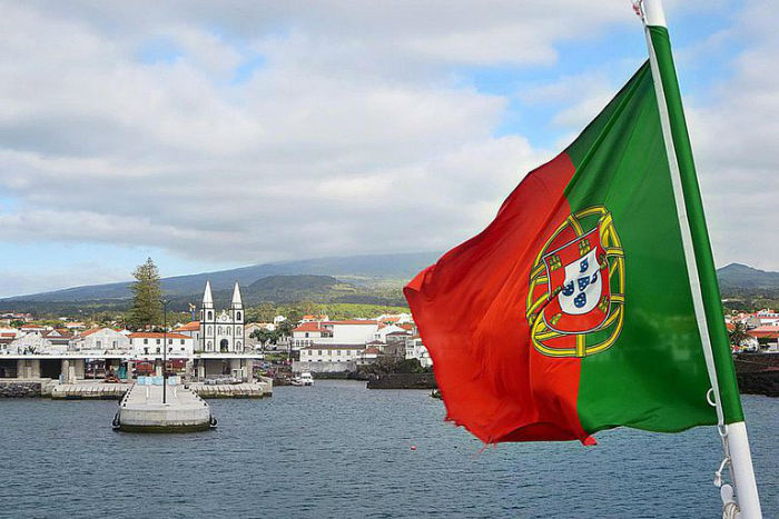 Portugal Flag 58b9cdd73df78c353c38480a w700 روزیاتو: هر آنچه که باید در مورد کشورهای کمونیستی امروزی بدانید اخبار IT